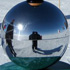 a bottle of Syrah atop an orb outside the McMurdo Station in Antarctica
